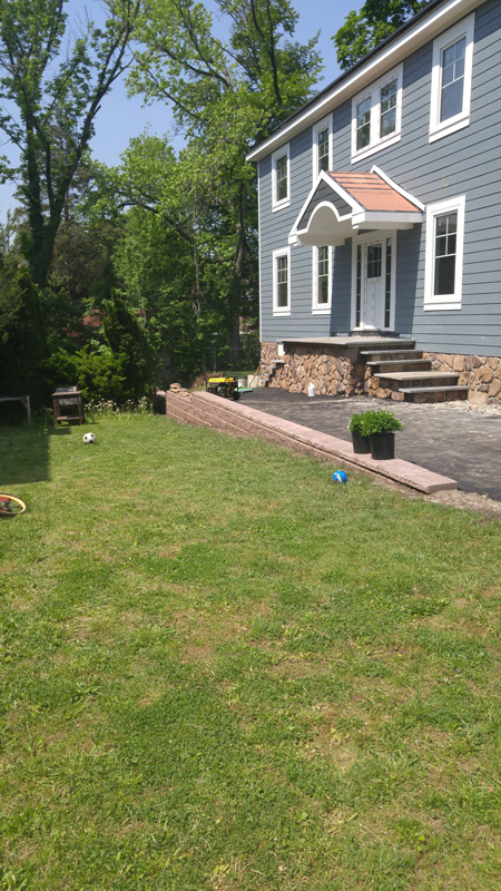 Finished Project: Paved driveway, added retaining wall, concrete  walkway and apron