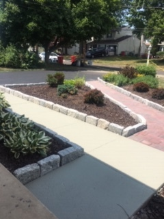 Pavers, concrete sidewalk, cobblestone edging, wider apron